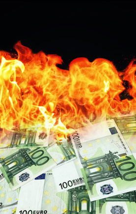 Money burns. Euro banknotes burning in flames.